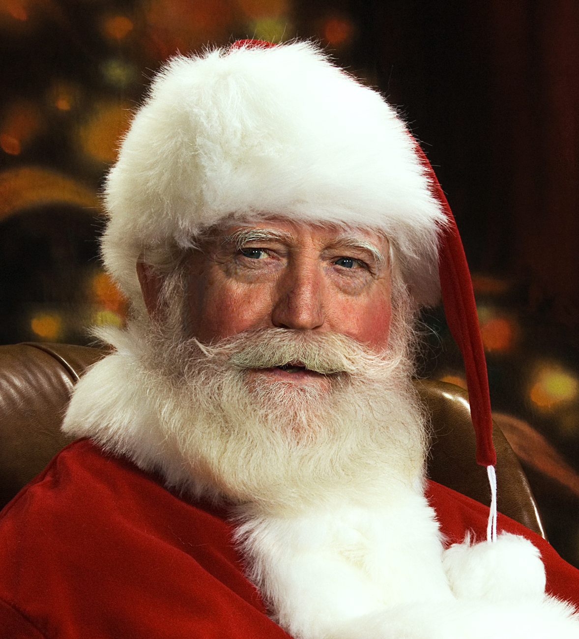 Can you guess the celeb hidden under Santa's beard ...